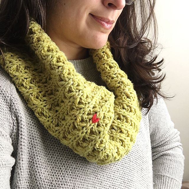 Margaux wearing a bright bulky chartreuse Penelope cowl with a contrasting Rare Stitch